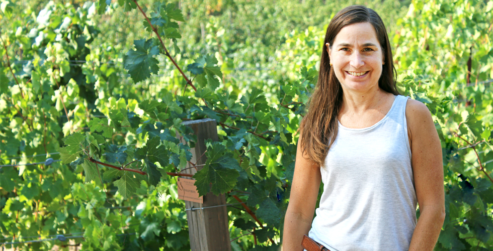 Hospitality Supervisor Stacie Dirito in the vineyards